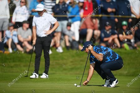 Cameron Smith of Australia (L) and Patrick Reed of the US on the seventh hole during the first round of The Open 2021 golf championship at Royal St George's golf course in Sandwich, Kent, Britain, 15 July 2021.