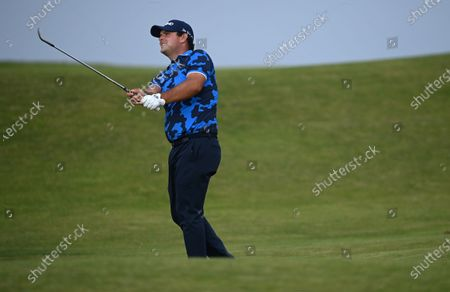 Patrick Reed of the US chips on the twelfth hole during the first round of The Open 2021 golf championship at Royal St George's golf course in Sandwich, Kent, Britain, 15 July 2021.