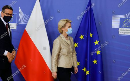 European Commission President Ursula von der Leyen, right, prepares to welcome Poland's Prime Minister Mateusz Morawiecki as he arrives for a bilateral meeting at EU headquarters in Brussels. The European Union's top court ruled Thursday, July 15, 2021 that Poland's way of disciplining judges is contrary to EU law, further acerbating relations between the bloc and its increasingly recalcitrant member states