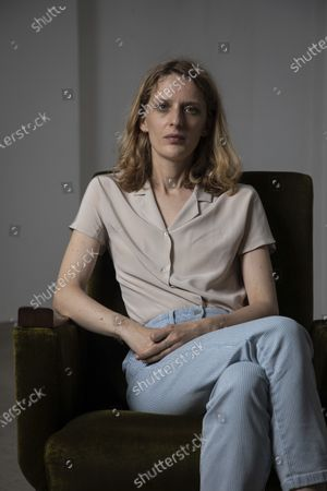 Director Mia Hansen-Love poses for portrait photographs for the film 'Bergman Island' at the 74th international film festival, Cannes, southern France
