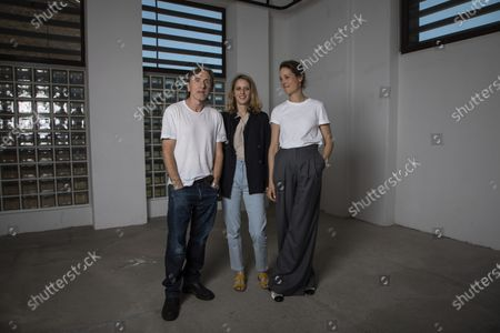 Stock Image of Tim Roth, from left, director Mia Hansen-Love, and Vicky Krieps pose for portrait photographs for the film 'Bergman Island' at the 74th international film festival, Cannes, southern France