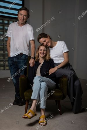 Stock Picture of Tim Roth, from left, director Mia Hansen-Love, and Vicky Krieps pose for portrait photographs for the film 'Bergman Island' at the 74th international film festival, Cannes, southern France