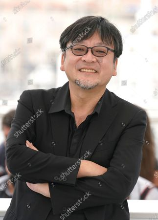 Director Mamoru Hosoda poses for photographers at the photo call for the film 'Belle' at the 74th international film festival, Cannes, southern France