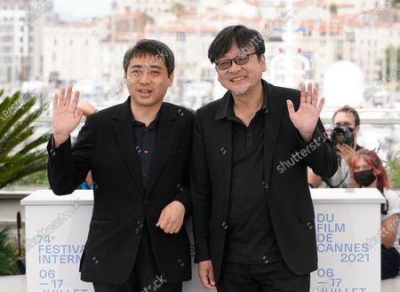 Yuichiro Saito, left, and director Mamoru Hosoda pose for photographers at the photo call for the film 'Belle' at the 74th international film festival, Cannes, southern France