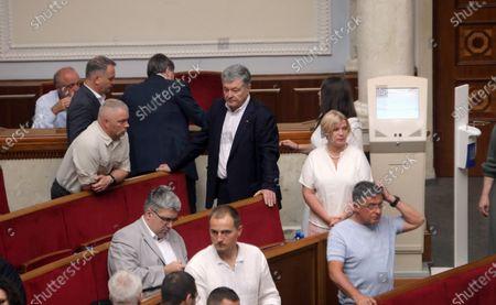European Solidarity MP Petro Poroshenko (C) attends a regular sitting of the Ukrainian parliament that saw 291 lawmakers vote for the dismissal of Interior Minister Arsen Avakov,  Kyiv, capital of Ukraine.
