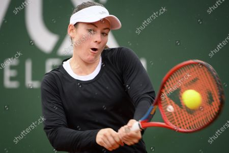 Tamara Zidansek from Slovenia in action against Mandy Minella of Luxembourg during their round of 16 match at the WTA International Ladies Open Lausanne tournament, in Lausanne, Switzerland, 15 July 2021.