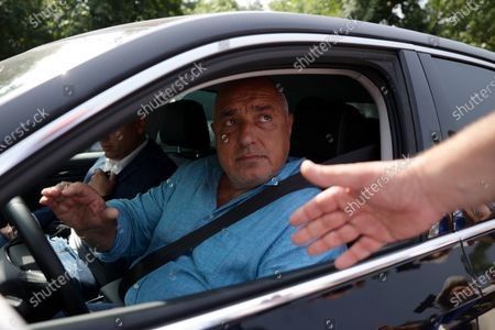 """Former Bulgarian Prime Minister and leader of the GERB party Boyko Borissov leaves the General Directorate """"National Police"""" where he was summoned for questioning."""