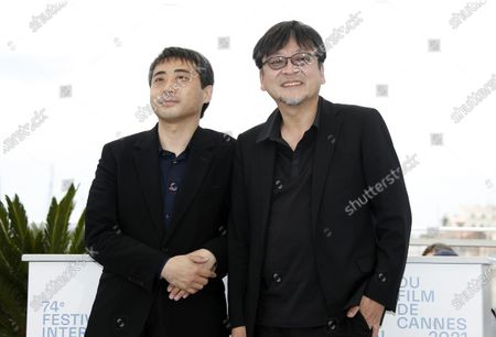 Mamoru Hosoda (R) and producer Yuichiro Saito pose during the photocall for 'Belle' at the 74th annual Cannes Film Festival, in Cannes, France, 15 July 2021. The festival runs from 06 to 17 July.