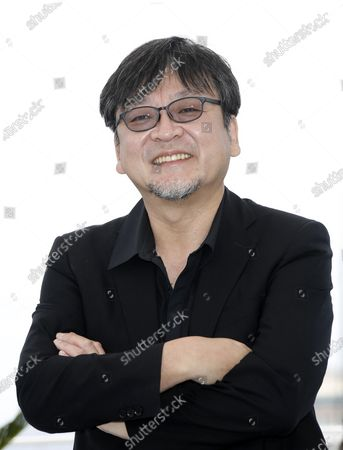 Mamoru Hosoda poses during the photocall for 'Belle' at the 74th annual Cannes Film Festival, in Cannes, France, 15 July 2021. The festival runs from 06 to 17 July.