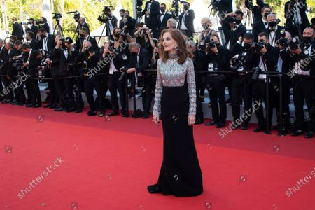 Isabelle Huppert poses for photographers upon arrival at the premiere of the film 'Aline' at the 74th international film festival, Cannes, southern France