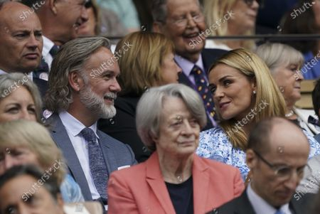 Stock Image of Singer Katherine Jenkins talks to chef Marcus Wareing, in the Royal Box on Centre Court