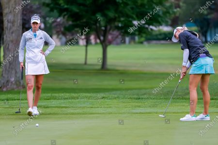 Sisters Jessica Korda (R) of the US and Nelly Korda (L) of the US in action on the tenth hole during the second round of the Dow Great Lakes Bay Invitational women's golf tournament at the Midland Country Club in Midland, Michigan, USA, 15 July 2021.