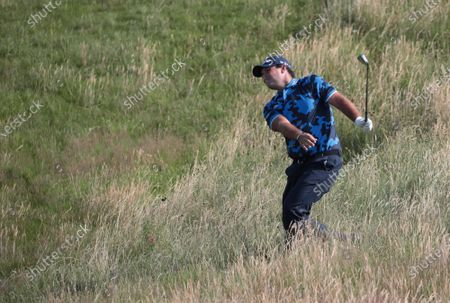 Patrick Reed of the USA hits out of the rough on the seventh hole on the first day of the Open Championship at Royal St George's in Sandwich, England on Thursday, July 15, 2021.