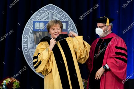 German Chancellor Angela Merkel is awarded with a Doctor of Humane Letters, honoris causa, by John Hopkins University President Ronald Daniels at the Johns Hopkins School of Advanced International Studies campus in Washington
