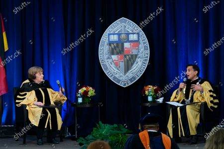 Stock Picture of German Chancellor Angela Merkel answers questions from John Hopkins University President Ronald Daniels after receiving her Doctor of Humane Letters, honoris causa, at the Johns Hopkins School of Advanced International Studies campus in Washington