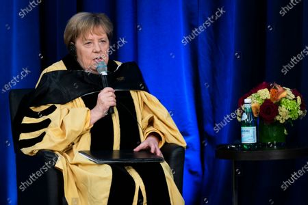 German Chancellor Angela Merkel speaks to invited guests and school officials after receiving her Doctor of Humane Letters, honoris causa, at the Johns Hopkins School of Advanced International Studies campus in Washington