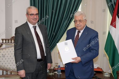 Editorial image of Palestinian president Mahmoud Abbas receives the annual report from a head of the Palestinian Monetary Authority, Ramallah, West Bank, Palestinian Territory - 15 Jul 2021