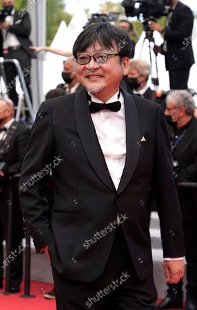 Mamoru Hosoda poses for photographers upon arrival at the premiere of the film 'France' at the 74th international film festival, Cannes, southern France