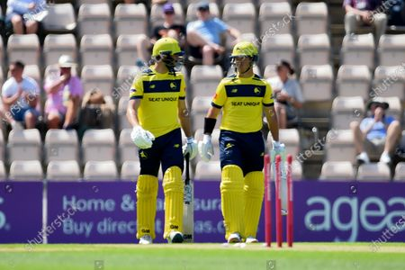 James Vince (left) and D'Arcy Short of Hampshire Hawks during the Vitality T20 Blast match between Hampshire Hawks and Essex Eagles at The Ageas Bowl, Southampton