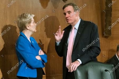Sen. Elizabeth Warren, D-Mass. speaks with Sen. Mark Warner, D-Va., during the hearing with Federal Reserve Board Chair Jerome Powell, before Senate Banking, Housing, and Urban Affairs hearing to examine the Semiannual Monetary Policy Report to Congress, on Capitol Hill in Washington