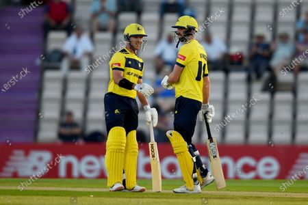 D'Arcy Short (left) and James Vince of Hampshire Hawks during the Vitality T20 Blast match between Hampshire Hawks and Sussex Sharks at The Ageas Bowl, Southampton