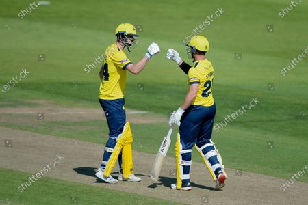 James Vince (left) and D'Arcy Short of Hampshire Hawks during the Vitality T20 Blast match between Hampshire Hawks and Glamorgan at The Ageas Bowl, Southampton