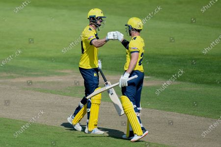 Stock Image of James Vince (left) and D'Arcy Short of Hampshire Hawks during the Vitality T20 Blast match between Hampshire Hawks and Glamorgan at The Ageas Bowl, Southampton