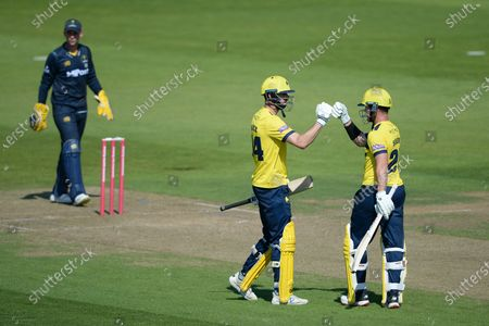 James Vince and D'Arcy Short of Hampshire Hawks during the Vitality T20 Blast match between Hampshire Hawks and Glamorgan at The Ageas Bowl, Southampton