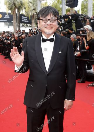 Stock Photo of Mamoru Hosoda arrives for the screening of 'France' during the 74th annual Cannes Film Festival, in Cannes, France, 15 July 2021. The movie is presented in the Official Competition of the festival which runs from 06 to 17 July.