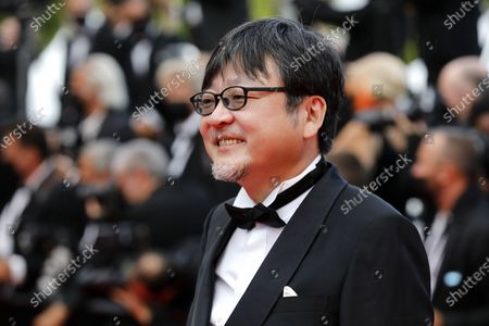 Mamoru Hosoda arrives for the screening of 'France' during the 74th annual Cannes Film Festival, in Cannes, France, 15 July 2021. The movie is presented in the Official Competition of the festival which runs from 06 to 17 July.