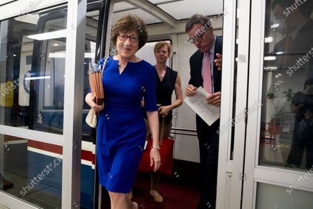 Republican Senator from Maine Susan Collins (L) and Democratic Senator from Virginia Mark Warner (R) walk off the Senate subway during Senate voting on Capitol Hill in Washington, DC, USA, 15 July 2021. Senate Majority Leader Chuck Schumer announced that the Senate will vote on 21 July to open debate on a bipartisan infrastructure deal.