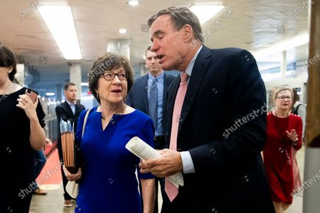 Republican Senator from Maine Susan Collins (L) and Democratic Senator from Virginia Mark Warner (R) walk together at the Senate subway during Senate voting on Capitol Hill in Washington, DC, USA, 15 July 2021. Senate Majority Leader Chuck Schumer announced that the Senate will vote on 21 July to open debate on a bipartisan infrastructure deal.