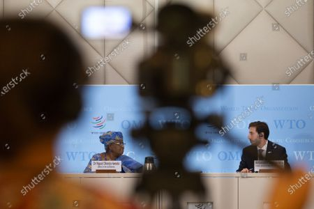 Director-General of the World Trade Organisation Ngozi Okonjo-Iweala, left, and Colombia's Ambassador Santiago Wills, right, fisheries subsidies negotiations chair, speak to the media during a press conference following a Fisheries Subsidies Meeting of the WTO Trade Negotiations Committee at Ministerial Level, at the headquarters of the World Trade Organization (WTO) in Geneva, Switzerland, 15 July 2021. A virtual meeting of ministers take place on 15 July to advance negotiations on curbing harmful fisheries subsidies.