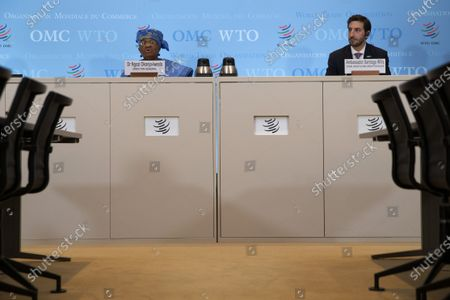 Stock Image of Director-General of the World Trade Organisation Ngozi Okonjo-Iweala, left, next to Colombia's Ambassador Santiago Wills, right, fisheries subsidies negotiations chair, speaks to the media during a press conference following a Fisheries Subsidies Meeting of the WTO Trade Negotiations Committee at Ministerial Level, at the headquarters of the World Trade Organization (WTO) in Geneva, Switzerland, 15 July 2021. A virtual meeting of ministers take place on 15 July to advance negotiations on curbing harmful fisheries subsidies.