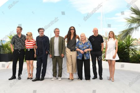 """Stock Picture of Melanie Thierry, Director Arnaud Larrieu, Mathieu Amalric, Director Jean-Marie Larrieu, Maiwenn, Josiane Balasko, Songwriter Dominique A and Galatea Bellugi attend the """"Tralala"""" photocall during the 74th annual Cannes Film Festival on July 14, 2021 in Cannes, France"""