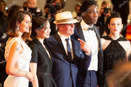 """Lea Mysius, Celine Sciamma, Jehnny Beth, Lucie Zhang, Makita Samba, Jacques Audiard, Noemie Merlant and Valerie Schermann attend the """"Les Olympiades (Paris 13th District)"""" screening during the 74th annual Cannes Film Festival on July 14, 2021 in Cannes, France."""