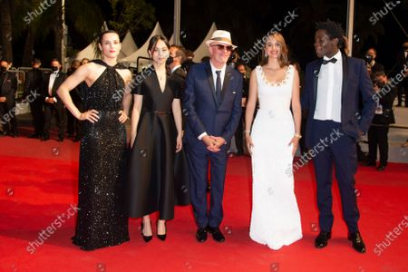 """Stock Photo of Lea Mysius, Celine Sciamma, Jehnny Beth, Lucie Zhang, Makita Samba, Jacques Audiard, Noemie Merlant and Valerie Schermann attend the """"Les Olympiades (Paris 13th District)"""" screening during the 74th annual Cannes Film Festival on July 14, 2021 in Cannes, France."""