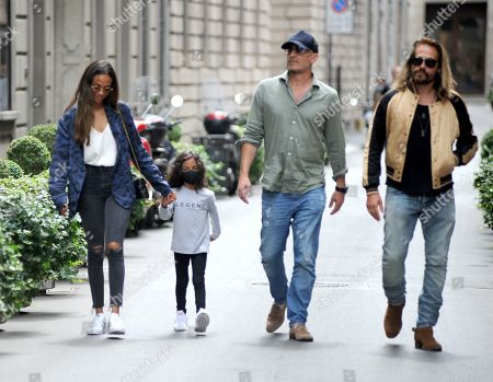Zoe Saldana and Marco Perego lunch at Salumaio di Montenapoleone before returning to the hotel, always escorted by a bodyguard.