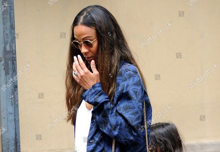 Stock Image of Zoe Saldana and Marco Perego lunch at Salumaio di Montenapoleone before returning to the hotel, always escorted by a bodyguard.
