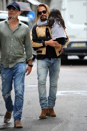 Stock Picture of Zoe Saldana and Marco Perego lunch at Salumaio di Montenapoleone before returning to the hotel, always escorted by a bodyguard.