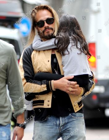 Stock Photo of Zoe Saldana and Marco Perego lunch at Salumaio di Montenapoleone before returning to the hotel, always escorted by a bodyguard.