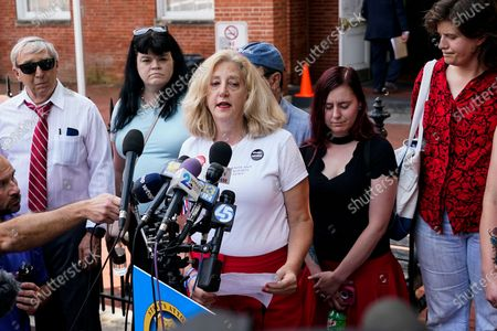 Stock Image of Andrea Chamblee, center, widow of Annapolis Capital Gazette reporter John McNamara, who died in the newsroom shooting in 2018, speaks during a press conference following a verdict in the trial of Jarrod W. Ramos, in Annapolis, Md. The jury found the gunman who killed five people at the newspaper criminally responsible, rejecting defense attorneys' mental illness arguments