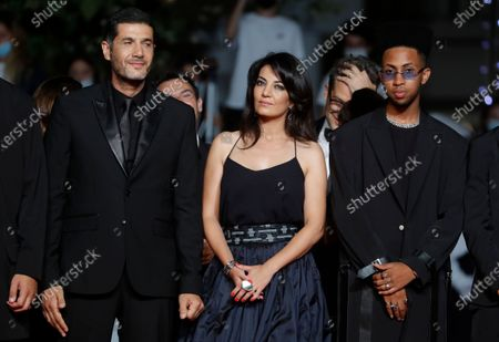 Ismail Adouab, Maryam Touzani, and Nabil Ayouch arrive for the screening of 'Haut Et Fort (Casablanca Beats)' during the 74th annual Cannes Film Festival, in Cannes, France, 15 July 2021. The movie is presented in the Official Competition of the festival which runs from 06 to 17 July.