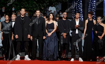 Sofia Akhmisse, Amina Kannan, Mehdi Razzouk, Ismail Adouab, Maryam Touzani, Nabil Ayouch, Anas Basbousi, and Meriem Nakkach arrive for the screening of 'Haut Et Fort (Casablanca Beats)' during the 74th annual Cannes Film Festival, in Cannes, France, 15 July 2021. The movie is presented in the Official Competition of the festival which runs from 06 to 17 July.
