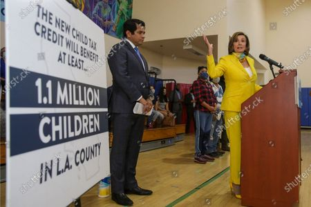 Stock Photo of U.S. Representative Jimmy Gomez, left, watches as House Speaker Nancy Pelosi, talks about the expanded Child Tax Credit at a press conference held at Barrio Action Youth and Family Center on Thursday, July 15, 2021 in Los Angeles, CA. (Irfan Khan / Los Angeles Times)