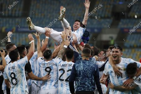 Teammates lift Argentina's Lionel Messi after their 1-0 victory over Brazil during the Copa America final soccer match at Maracana stadium in Rio de Janeiro, Brazil