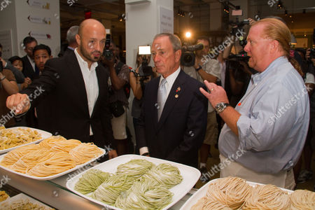 Stock Picture of Joseph Bastianich, Mayor Michael Bloomber and Mario Batali tour Eataly