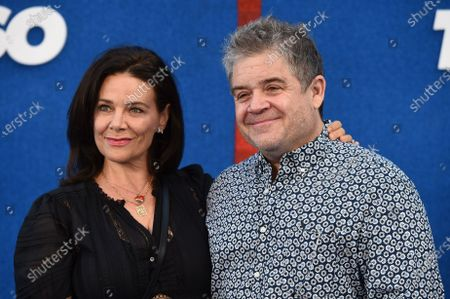 """Patton Oswalt and Meredith Salenger arrive at the premiere of the second season of """"Ted Lasso"""", at the Pacific Design Center"""