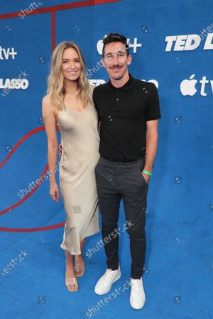"""Stock Image of Jamie Lee Darley and Sacha Kljestan attend Apple""""s """"Ted Lasso"""" season two premiere at the Pacific Design Center. """"Ted Lasso"""" season two will premiere globally on Apple TV+ on July 23rd."""