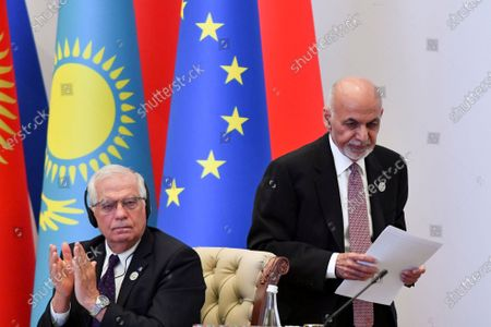 Representative of the EU for Foreign Affairs and Security Policy, Josep Borrell, left, applauds as Afghanistan's President Ashraf Ghani, walks past during the Central and South Asia 2021 conference in Tashkent, Uzbekistan